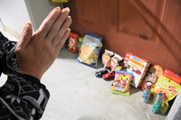 """Candy, toys and other items are seen left outside the apartment where Orito Niimura, 3, died, in the city of Settsu, Osaka Prefecture, on Sept. 23, 2021. A female resident who brought a Mainichi Shimbun reporter to the scene wept as she brought their hands together in prayer, and said, """"He must have wanted to play more."""" (Mainichi/Yusuke Kori)"""