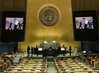 Members of South Korean K-pop band BTS watch a music video on the General Assembly Hall monitors during a meeting on Sustainable Development Goals at the 76th session of the U.N. General Assembly at U.N. headquarters, on Sept. 20, 2021. (John Angelillo/Pool Photo via AP)