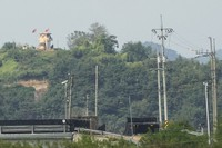 A military guard post of North Korea, left top, is seen in Paju, near the border with North Korea, South Korea, on Sept. 24, 2021. (AP Photo/Ahn Young-joon)