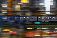 People wearing protective masks are seen on a train that is traveling through Shinjuku district in Tokyo on Sept. 22, 2021. (AP Photo/Kiichiro Sato)