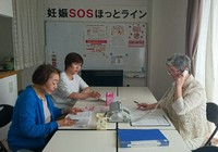 Embryo Hokkaido staff are consulted via a phone call in this photo provided by the group.