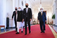 U.S. President Joe Biden walks to the Quad summit with, from left, Australian Prime Minister Scott Morrison, Indian Prime Minister Narendra Modi, and Japanese Prime Minister Yoshihide Suga, in the East Room of the White House on Sept. 24, 2021, in Washington. (AP Photo/Evan Vucci)