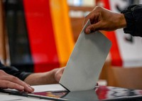 A man casts his ballot for the German elections in a polling station in Berlin, Germany, Sunday, Sept. 26, 2021. (AP Photo/Michael Probst)