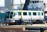 A new train carriage for use on the Fukuoka City Subway is seen after it landed at Hakata Port in Fukuoka's Hakata Ward on Sept. 27, 2021. (Mainichi/Tomohisa Yazu)