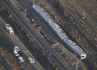 This aerial view taken on Sept. 26, 2021, shows part of an Amtrak train that derailed in north-central Montana Saturday that killed multiple people and left others hospitalized, officials said. (Larry Mayer/The Billings Gazette via AP)