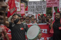 Members of the Communist Party of India shout slogans during a protest against farm laws in Mumbai, India on Sept. 27, 2021. (AP Photo/Rafiq Maqbool)