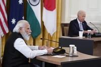 Indian Prime Minister Narendra Modi speaks during the Quad summit with President Joe Biden, Australian Prime Minister Scott Morrison and Japanese Prime Minister Yoshihide Suga in the East Room of the White House, on Sept. 24, 2021, in Washington. (AP Photo/Evan Vucci)