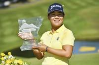 Nasa Hataoka, of Japan, holds the trophy after winning the LPGA Walmart NW Arkansas Championship golf tournament, on Sept. 26, 2021, in Rogers, Ark. (AP Photo/Michael Woods)