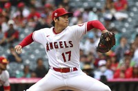 Los Angeles Angels pitcher Shohei Ohtani throws to home plate during the first inning of a baseball game against the Seattle Mariners, on Sept. 26, 2021, in Anaheim, Calif. (AP Photo/Michael Owen Baker)
