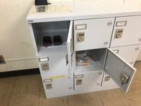 This photo provided by West Japan Railway Co. shows a locker at Shin-Iwakuni Station. An alcohol tester was stored in the upper left compartment, and the leaked alcohol disinfectant spray was in the center compartment.