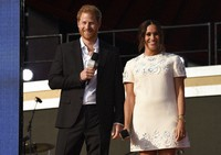 Prince Harry, the Duke of Sussex, left, and Meghan, the Duchess of Sussex speak at Global Citizen Live in Central Park on Sept. 25, 2021, in New York. (Photo by Evan Agostini/Invision/AP)