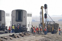 Workers examine a train car, on Sept. 27, 2021, from an Amtrak train that derailed near Joplin, Mont. (AP Photo/Ted S. Warren)