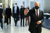 German Finance Minister Olaf Scholz and Social Democratic Party candidate for chancellor arrives for the first faction meeting of the party's lawmaker at the parliament Bundestag in Berlin, on Sept. 28, 2021. (AP Photo/Markus Schreiber)