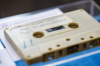 In this Sept. 24, 2021 file photo, a view of a cassette with the recording of four Danish schoolboys' interviews with John Lennon and Yoko Ono during the famous couple's winter stay in Thy, in Jutland, Denmark, in 1970, on display at Bruun Rasmussen Auction House in Copenhagen. (Ida Marie Odgaard/Ritzau Scanpix via AP)