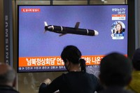 People watch a TV showing a file image of North Korea's missile launch during a news program at the Seoul Railway Station in Seoul, South Korea, on Sept. 28, 2021. (AP Photo/Ahn Young-joon)