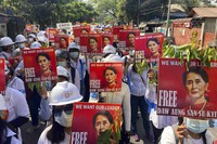 In this March 5, 2021, file photo, protesters hold portraits of deposed Myanmar leader Aung San Suu Kyi during an anti-coup demonstration in Mandalay, Myanmar. (AP Photo)
