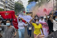 In this July 7, 2021, file photo, students protest against the February military takeover by the State Administration Council as they march in Kyauktada township in Yangon, Myanmar. (AP Photo)