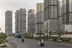 高層住宅が建設されている現場(中国・上海) Bloomberg