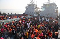 In this Dec. 29, 2020, file photo, Rohingya refugees wait on naval ships to be transported to an isolated island in the Bay of Bengal, in Chittagong, Bangladesh. (AP Photo/Mahmud Hossain Opu)