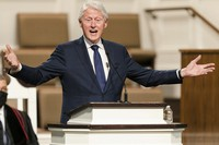 """In this Jan. 27, 2021 file photo, former U.S. President Bill Clinton speaks during funeral services for Henry """"Hank"""" Aaron, at Friendship Baptist Church in Atlanta. (Kevin D. Liles/Atlanta Braves via AP, Pool)"""