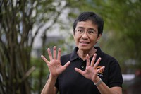Rappler CEO and Executive Editor Maria Ressa gestures during an interview at a restaurant in Taguig city, Philippines, on Oct. 9, 2021. (AP Photo/Aaron Favila)