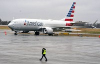 An American Airlines Boeing 737 Max jet plane is parked at a maintenance facility in Tulsa, Okla., Wednesday, Dec. 2, 2020. A former Boeing test pilot pleaded not guilty Friday, Oct. 15, 2021, to charges that he deceived regulators by withholding information about a key system that played a role in two deadly crashes involving Boeing 737 Max jets. (AP Photo/LM Otero, File)