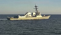 In this photo taken from video released by the Russian Defense Ministry Press Service, the U.S. destroyer USS Chafee is seen from Russian navy's Admiral Tributs destroyer near Russian territorial waters in the Sea of Japan on Oct. 15, 2021. (Russian Defense Ministry Press Service via AP)