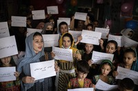 Women and teachers demonstrate inside a private school to demand their rights and equal education for women and girls, during a gathering for National Teachers Day, in Kabul, Afghanistan, on Oct. 5, 2021. (AP Photo/Ahmad Halabisaz)