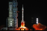 In this photo released by Xinhua News Agency, the crewed spaceship Shenzhou-13, atop a Long March-2F carrier rocket, is launched from the Jiuquan Satellite Launch Center in northwest China's Gobi Desert, on Oct. 16, 2021. (Li Gang/Xinhua via AP)