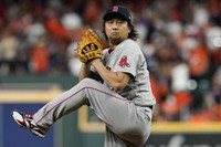Boston Red Sox pitcher Hirokazu Sawamura throws against the Houston Astros during the eighth inning in Game 1 of baseball's American League Championship Series on Oct. 15, 2021, in Houston. (AP Photo/Tony Gutierrez)