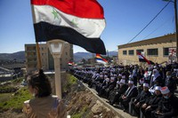 In this Feb. 14, 2021 file photo, Druse supporters of Syrian President Bashar Assad wave Syrian flags during a rally close to the Syrian border demanding the return of the Golan Heights, captured by Israel in 1967, in Majdal Shams, Golan Heights. (AP Photo/Oded Balilty, File)