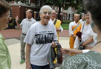In this Aug. 9, 2012, file photo, Sister Megan Rice, center, and Michael Walli, in the background waving, are greeted by supporters as they arrive for a federal court appearance in Knoxville, Tenn., after being charged with sabotaging a government nuclear complex.(Michael Patrick/Knoxville News Sentinel via AP)