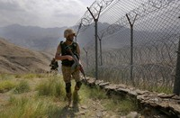 In this Aug. 3, 2021 file photo, Pakistan Army troops patrol along the fence on the Pakistan Afghanistan border at Big Ben hilltop post in the Khyber district, Pakistan. (AP Photo/Anjum Naveed)