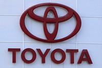 The Toyota logo is seen on a dealership in Manchester, New Hampshire, on Aug. 15, 2019. (AP Photo/Charles Krupa)