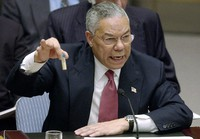In this Feb. 5, 2003 file photo, U.S. Secretary of State Colin Powell holds up a vial he said could contain anthrax as he presents evidence of Iraq's alleged weapons programs to the United Nations Security Council. (AP Photo/Elise Amendola)