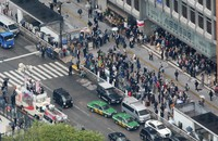 People who have gathered to hear the stump speech of a party leader after the House of Representatives election was announced, are seen in Tokyo's Shinjuku Ward on Oct. 19, 2021, from a Mainichi Shimbun helicopter. The photo is partially modified. (Mainichi/Akihiro Ogomori)