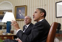 In this Dec. 1, 2010 file photo, President Barack Obama talks with reporters after his meeting with former Secretary of State Colin Powell, left, on the importance of ratifying the New START Treaty, in the Oval Office at the White in Washington. (AP Photo)
