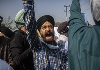 In this Oct. 8, 2021, file photo, Sikh community members shout slogans during the funeral of Supinder Kaur, a slain school principal in Srinagar, India. (AP Photo/Mukhtar Khan)