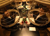 People enjoy a meal without masks under transparent lanterns as part of the Tokyo lantern dinner service launched at the Hoshinoya Tokyo resort hotel in the capital's Chiyoda Ward on Oct. 19, 2021. (Mainichi/Kimi Takeuchi)