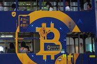 This May 12, 2021, file photo shows an advertisement for the cryptocurrency Bitcoin displayed on a tram in Hong Kong. (AP Photo/Kin Cheung)