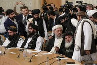 Taliban official Abdul Salam Hanafi, center, and other members of the political delegation from the Afghan Taliban's movement arrive to attend the talks involving Afghan representatives in Moscow, Russia, on Oct. 20, 2021. (AP Photo/Alexander Zemlianichenko, Pool)