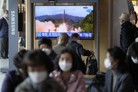 A TV screen showing a news program reporting about North Korea's missile launch with file footage is seen at a train station in Seoul, South Korea, on Oct. 19, 2021. (AP Photo/Lee Jin-man)