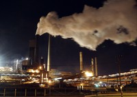In this July 8, 2011 file photo, smoke bellows from a chimney stack at BlueScope Steel's mill at Port Kembla, south of Sydney, Australia. (AP Photo/Rob Griffith)