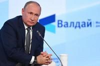 Russian President Vladimir Putin attends the annual meeting of the Valdai Discussion Club in the Black Sea resort of Sochi, Russia, on Oct. 21, 2021. (Maksim Blinov, Sputnik, Kremlin Pool Photo via AP)
