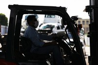 """Zadran is seen driving a forklift at his job, in the city of Bando, Ibaraki Prefecture, on Sept. 24, 2021. He has not been able to return home to Afghanistan for two years, and has yet to meet his 1-year-old son Wahid. He has advised his family to refrain from leaving the house while the direction of the Taliban administration remains obscure. """"I'm concerned about where it will head,"""" he said. (Mainichi/Masahiro Ogawa)"""