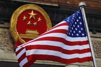 In this Nov. 9, 2017 file photo, an American flag is flown next to the Chinese national emblem. (AP Photo/Andy Wong)
