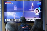 People watch a TV screen showing images of North Korea's ballistic missile launched from a submarine during a news program at Seoul Railway Station in Seoul, South Korea, on Oct. 20, 2021. (AP Photo/Ahn Young-joon)