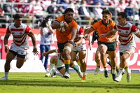 Australia's Rob Leota makes a run during the rugby international between the Wallabies and Japan in Oita, Japan, on Oct. 23, 2021. (AP Photo/Hiro Komae)
