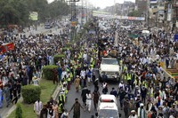 A covey of supporters of Tehreek-e-Labiak Pakistan, a banned radical Islamist party, moves toward Islamabad during a protest march, on the outskirts of Lahore, Pakistan, Saturday, Oct. 23, 2021. (AP Photo/K.M. Chaudary)