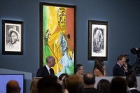 Buyers and attendees mingle during an auction of Pablo Picasso's master works at the Bellagio hotel and casino on Oct. 23, 2021, in Las Vegas. (AP Photo/Ellen Schmidt)